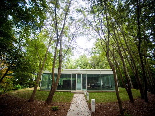The exterior of the 1,600-square-foot glass box home built by the late William Starke Shell. A longtime University of Tennessee architecture professor, Shell built his dream house with clean lines, transparent materials and minimal furniture in the modernism style.