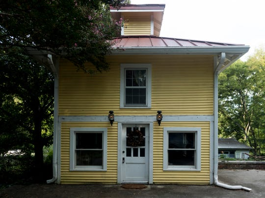 Jon and Taylor Harris' 1885 home includes a carriage house.