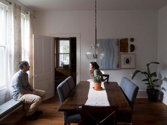 Jon and Taylor Harris in their dining room of their 1885 home in Historic Concord Village on Monday, August 27, 2018.
