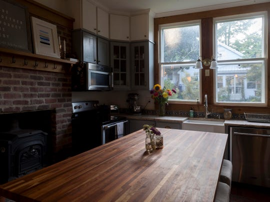 The kitchen of Jon and Taylor Harris' 1885 home in Historic Concord Village on Monday, August 27, 2018.