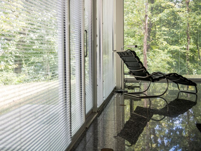 The 1,600-square-foot glass home built by the late William Starke Shell is transparent, but there are mini-blinds on the wall panels. There are no adjacent houses, and Shell bought the adjoining tree-covered lot in 1986. That lot and the furniture are also part of the Knoxville Museum of Art's $575,000 asking price for the house.