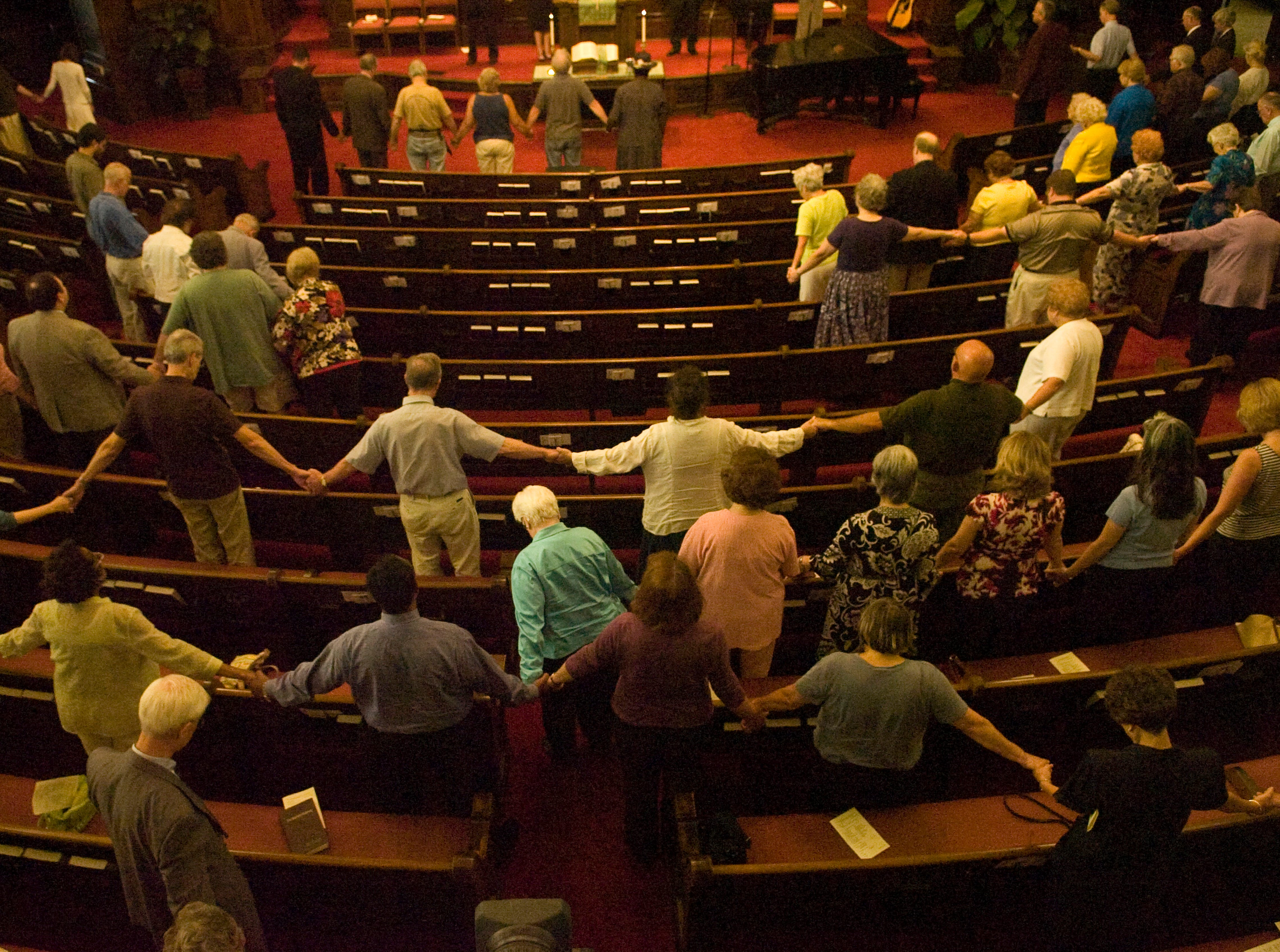 More than 150 people join hands in prayer Tuesday, July 29, 2008, during a noon ecumenical service at First Baptist Church of Knoxville for the Tennessee Valley Unitarian Universalist Church congregation and the victims of a Sunday morning shooting.