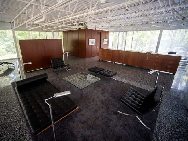 The living area of the 1,600-square-foot glass house that the late University of Tennessee professor William Starke Shell built shows the house's custom furniture and how walls are created using rolling cabinets that double as storage. The house was a labor of love for Shell, who left it to the Knoxville Museum of Art when he died in 2017.