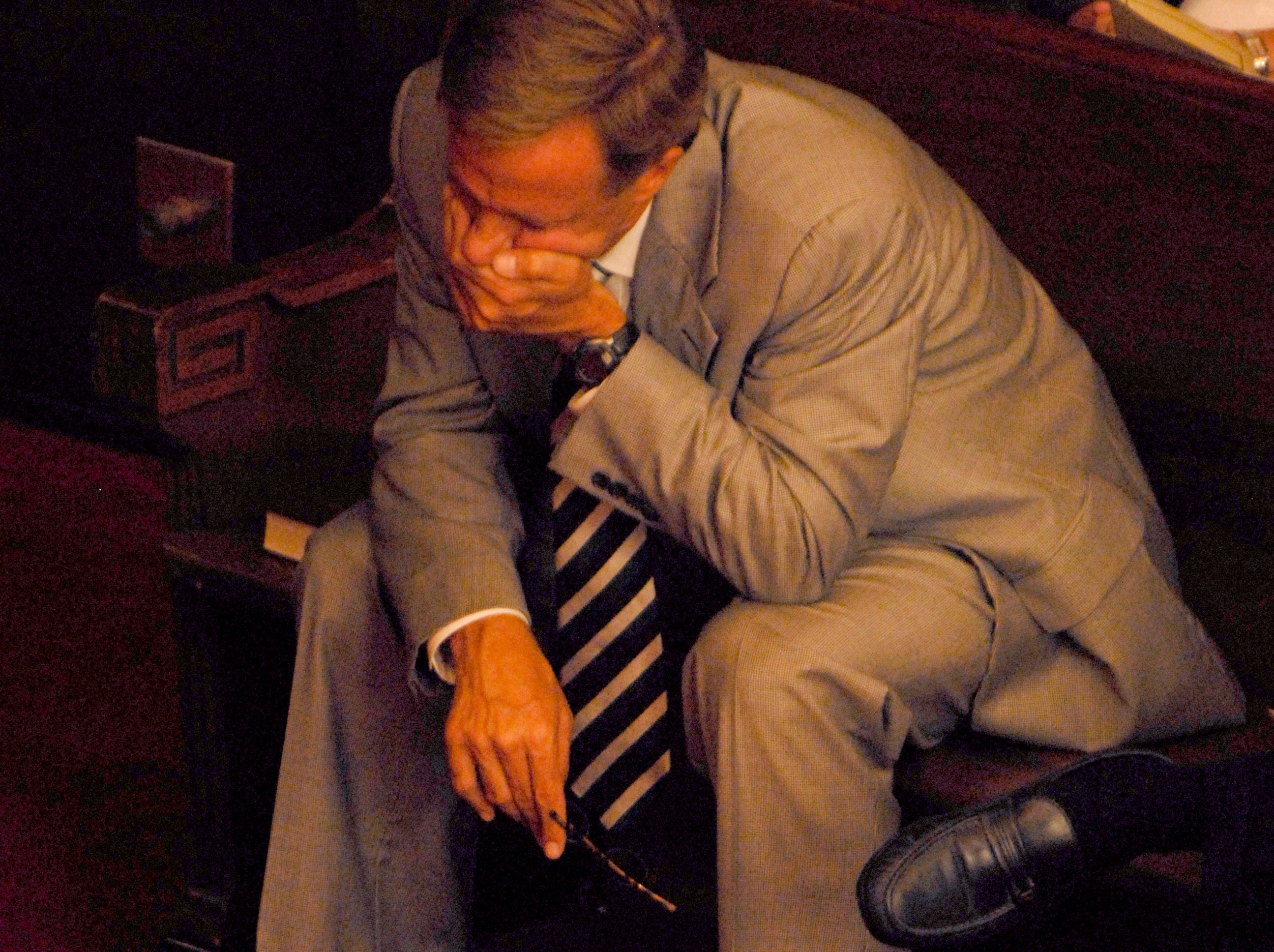 Knoxville Mayor Bill Haslam  bows his head during a prayer Tuesday, July 29, 2008, during a noon ecumenical service at First Baptist Church of Knoxville for the Tennessee Valley Unitarian Universalist Church congregation and the victims of a Sunday morning shooting.