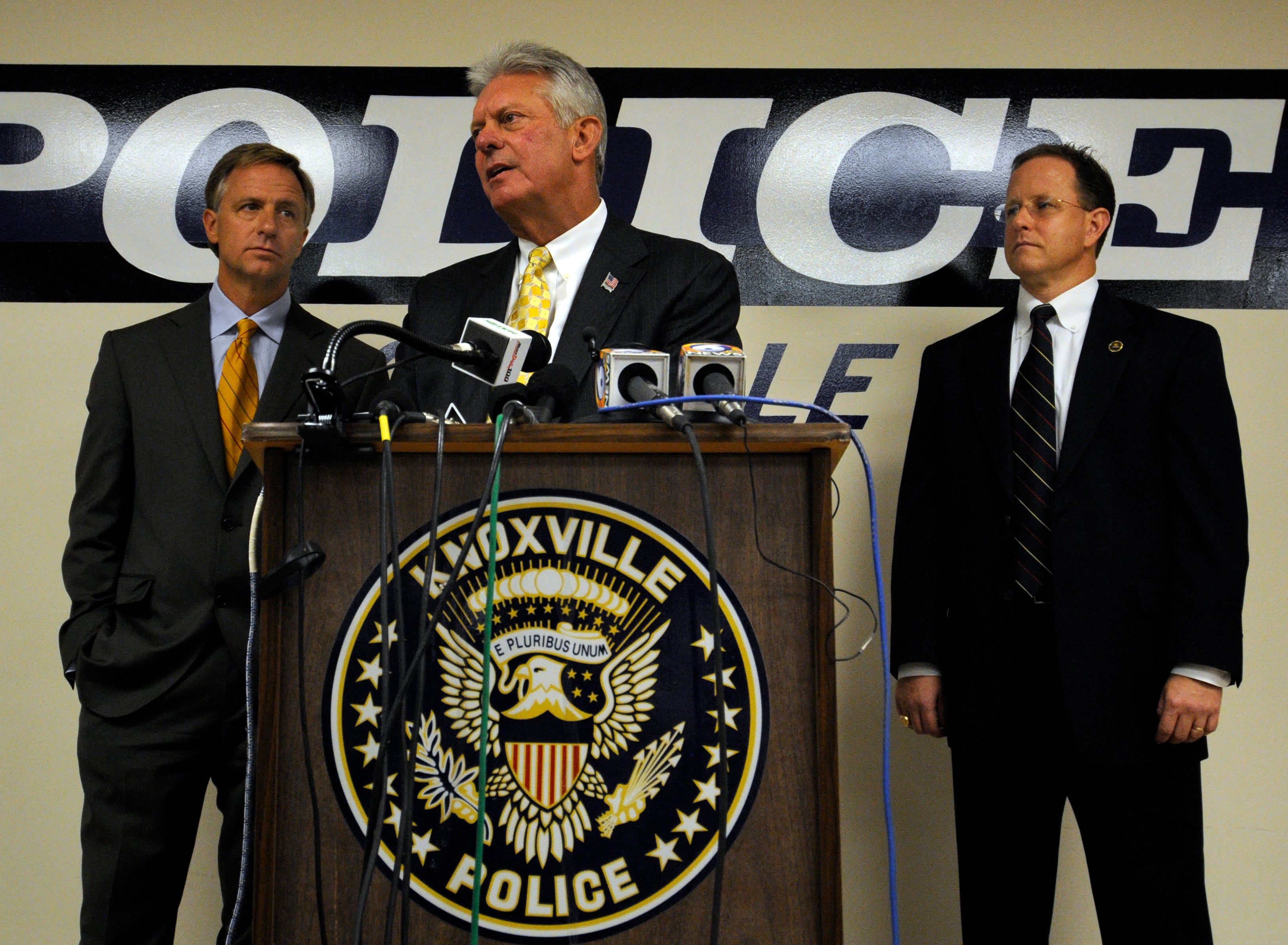 Knoxville Police Chief Sterling Owen IV, center, Mayor Bill Haslam, left, and FBI Special Agent in Charge Richard Lambert, right, hald a press conference Monday, Aug. 28, 2008 about the progress of the investigation into the shooting at the Tennessee Valley Unitarian Universalist Church.