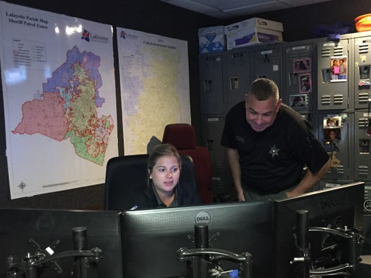 In this Sept. 4, 2018, file photo, deputies Molli LeBlanc, left, and Shannon Harrison work in the dispatch center of the Lafayette Parish Sheriff's Office.