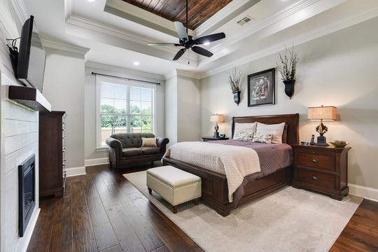 The master suite has views of the lovely property.