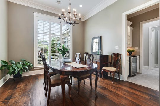 The formal dining area is perfect for family dinners.