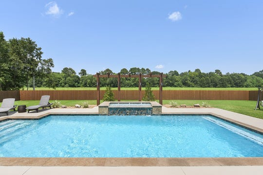 The gorgeous pool is an oasis for family gatherings.