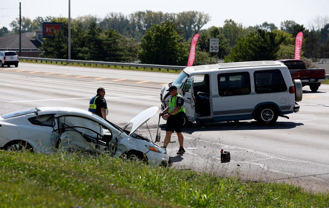 Lancaster Police officers investigate a two vehicle crash at North Memorial Drive and Whittier Drive Tuesday morning, Sept. 4, 2018, in Lancaster.