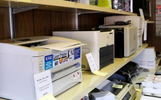 A row of printers sit on shelf at Heimberger Business Machines Tuesday, Sept. 4, 2018, in Lancaster. The company will close on Friday after 60 years of business.