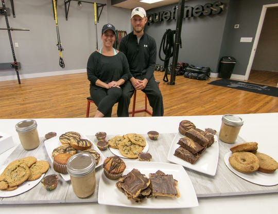 Keri and Greg Hayes offer a healthy alternative to popular snacks through their business Whey Better Bakery. The couple displays some of their offerings at their Brighton fitness studio, which is now called Studio 111, Tuesday, Sept. 4, 2018.