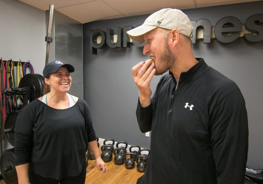 Greg Hayes samples one of his wife Keri Hayes's chocolate donuts Tuesday, Sept. 4, 2018, the donut made from healthy ingredients is one of the offerings from Whey Better Bakery.