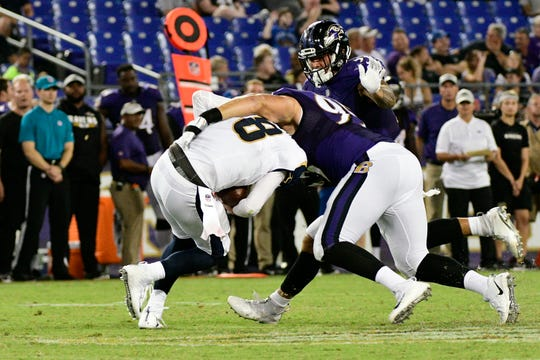 Baltimore Ravens defensive end Zach Sieler of Pinckney sacks Los Angeles Rams quarterback Brandon Allen during a preseason game.