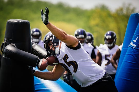 Zach Sieler of Pinckney goes through a drill during the Baltimore Ravens' rookie mini-camp.