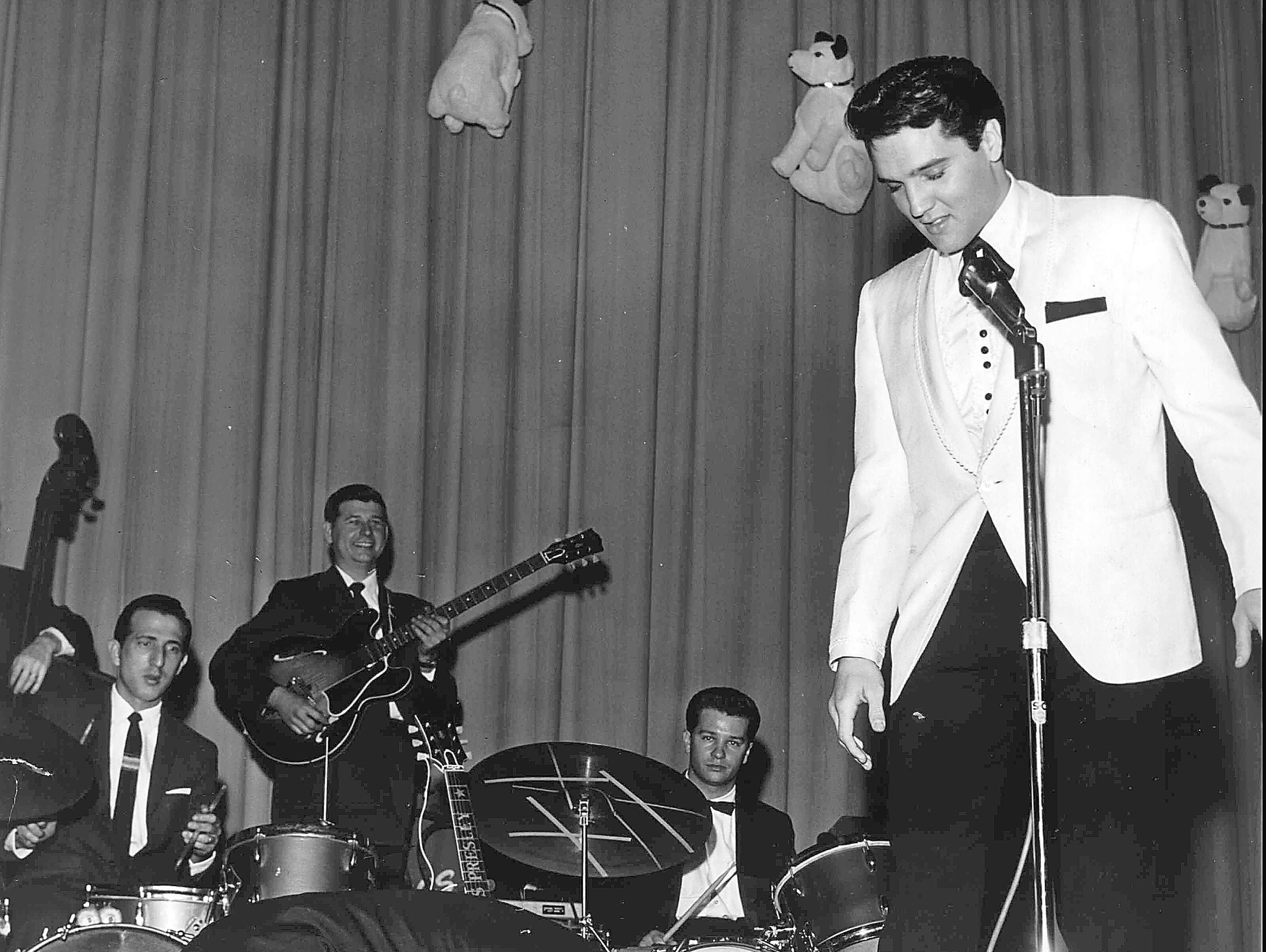 Comedian George Jessel hit the stage in an exaggerated salaam to the King of Rock 'n' Roll at Elvis' evening performance at Ellis Auditorium on Feb. 25, 1961. Jessel, the master of ceremonies, could not make it to the earlier matinee performance because of an airline strike. Elvis Presley Day began earlier with a luncheon honoring the singer at Hotel Claridge. More than $50,000 was raised for charity from the events.