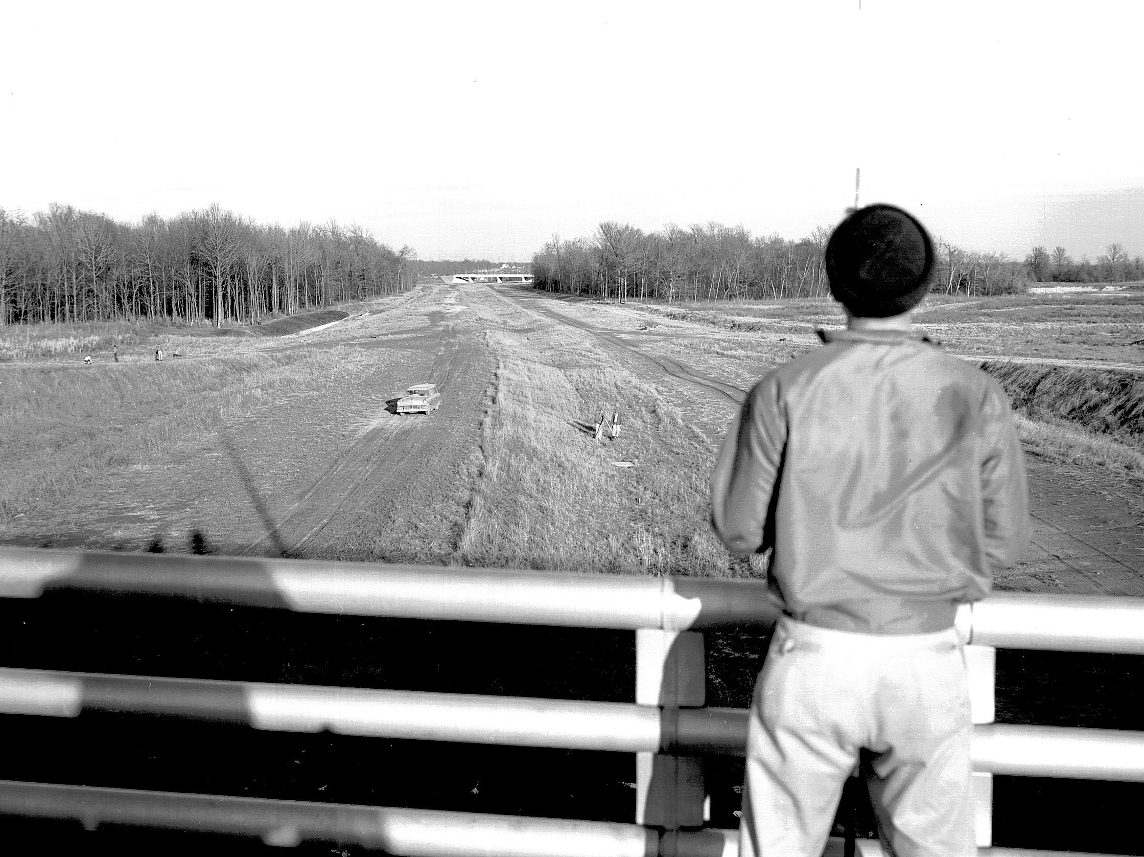 Paving of a stretch of the southeast circumferential expressway is expected to begin as soon as alignment work is completed. John A. Lloyd of the Tennessee Highway Department is looking east toward Mt. Moriah from Perkins in early March 1962.