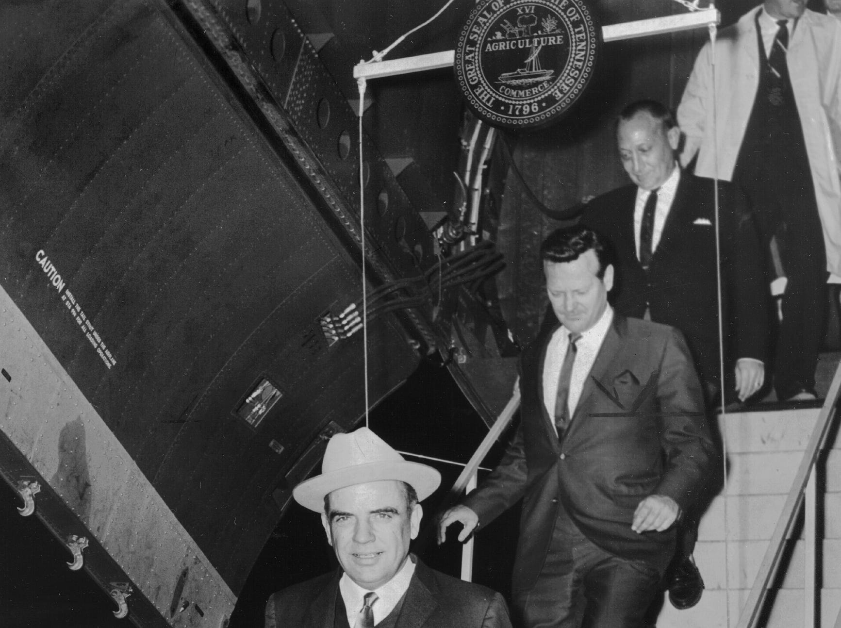 Tennessee Gov. Frank Clement leaves the National Guard transport plane that brought him to Memphis Metropolitan Airport on Dec. 21, 1965, to announce that Memphis has been awarded a giant new Radio Corporation of America television receiver manufacturing and distribution complex.