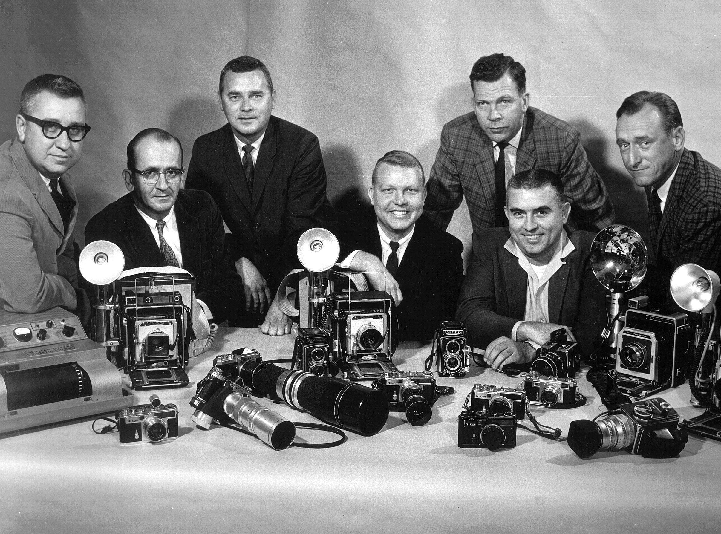 The photo staff of The Commercial Appeal in 1963 consisted of (From Left) Leonard Atkins, who handled telephoto operations, Fred J. Griffith, Barney Sellers, James Shearin, Bob Williams, Wayne Tilson and Charles Nicholas, Chief Photographer. Equipment pictured includes a United Press International telephoto transmitter, 4 x 5 Speed Graphic cameras, assorted models of Nikon 35mm cameras, Rolleiflex cameras and Hassleblad cameras.