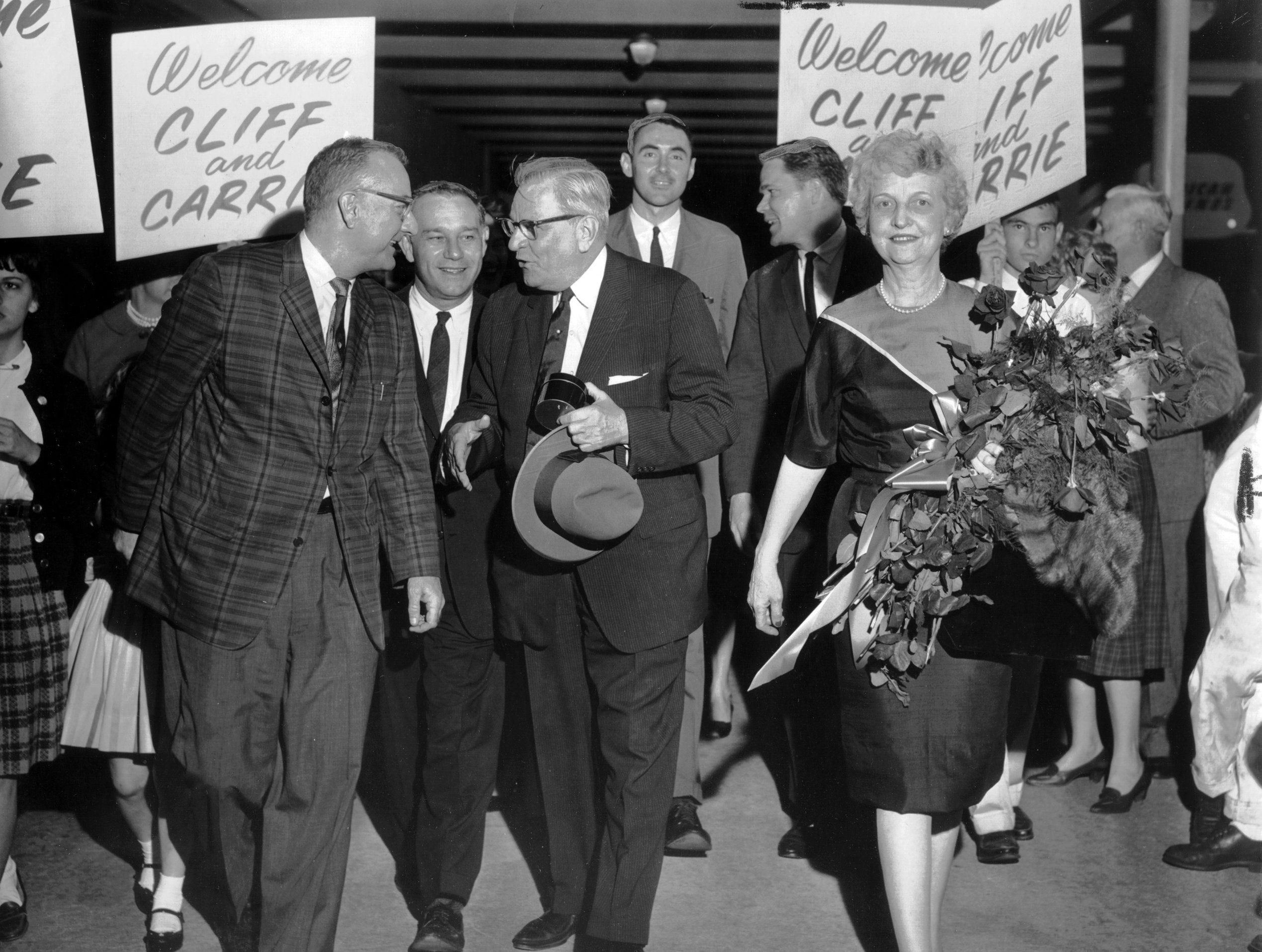 John Ford Canale (Left) and James Irwin (Center) were two of the supporters of Representative Clifford Davis (hat in hand) who met the veteran lawmaker on 17 Oct 1962 when he and Mrs. Davis arrived at Municipal Airport on their return from Washington.