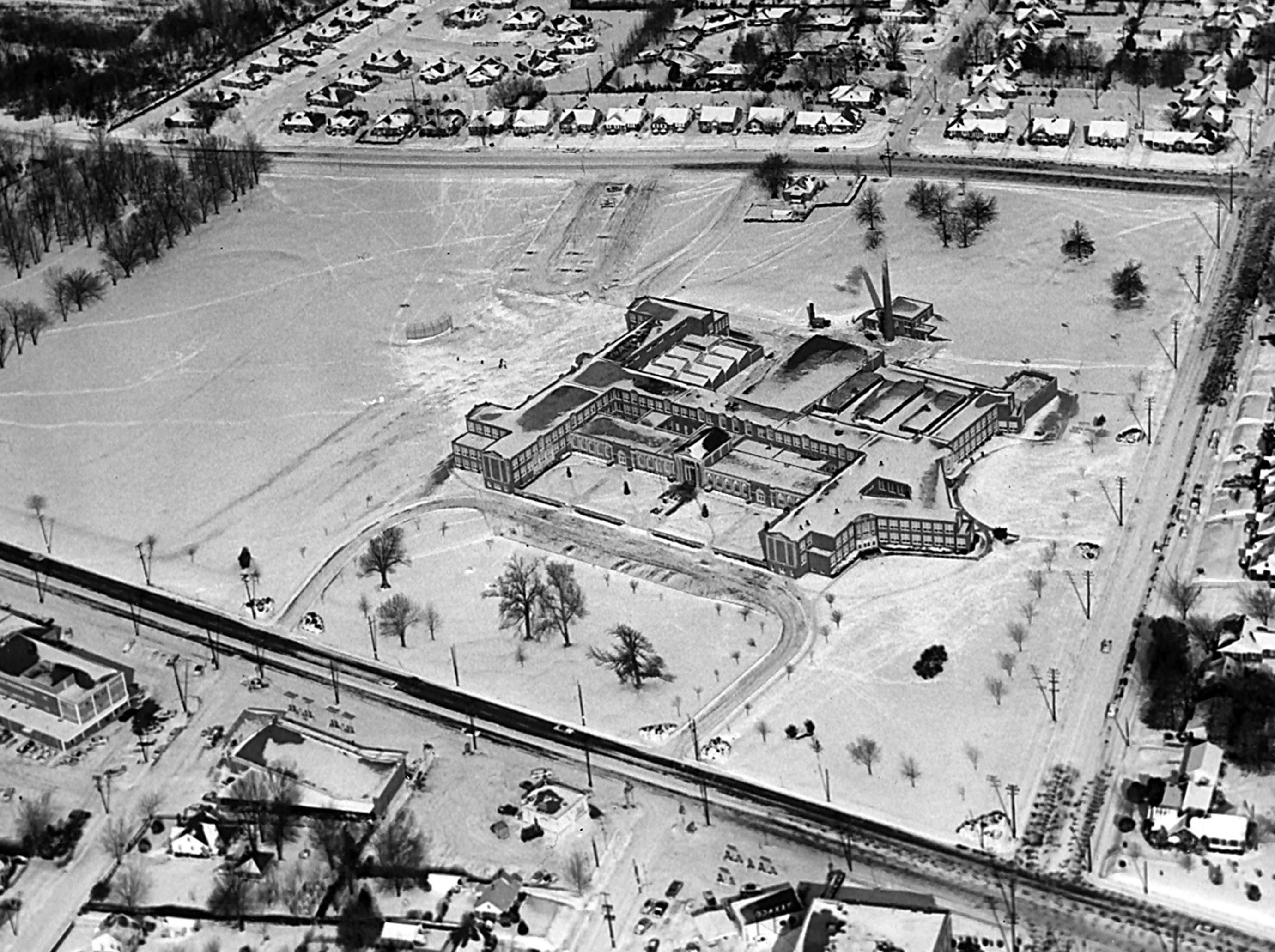 East High School is covered in a blanket of snow on Jan. 11, 1962. Poplar Avenue is at bottom of photo; Walnut Grove is seen at top.