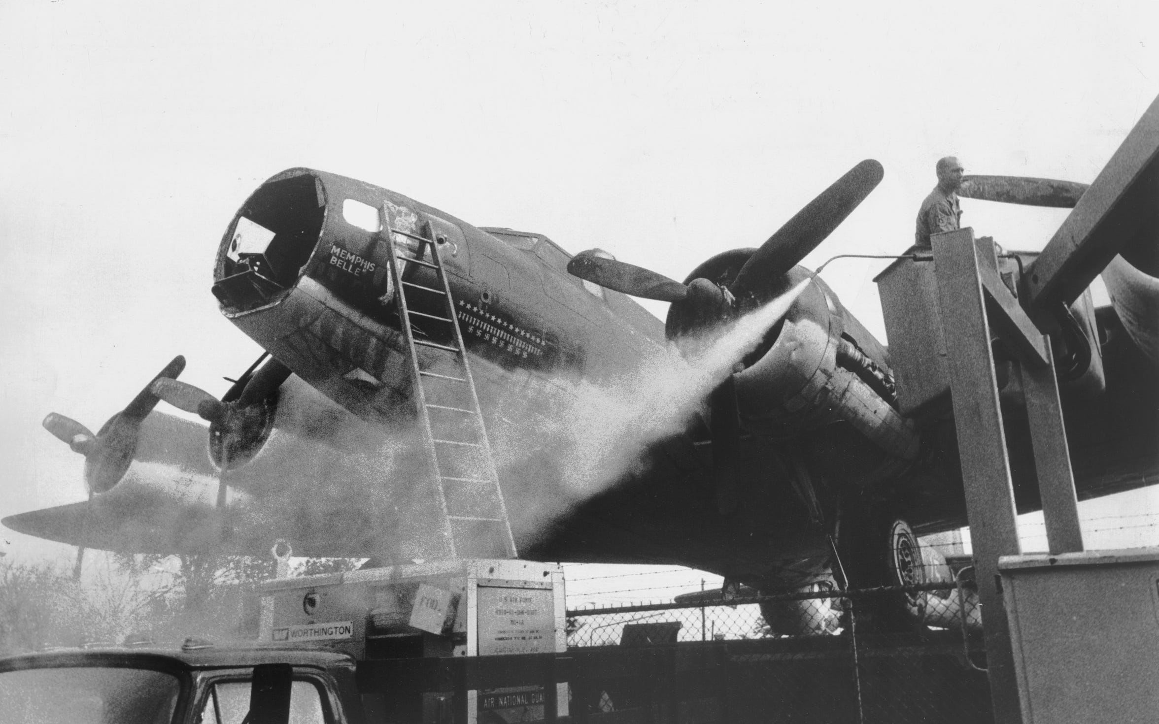 The Memphis Belle gets a bath and sprucing up on November 10, 1966, as it sits atop its pedestal in front of the National Guard Armory at the corner of Central and Hollywood.