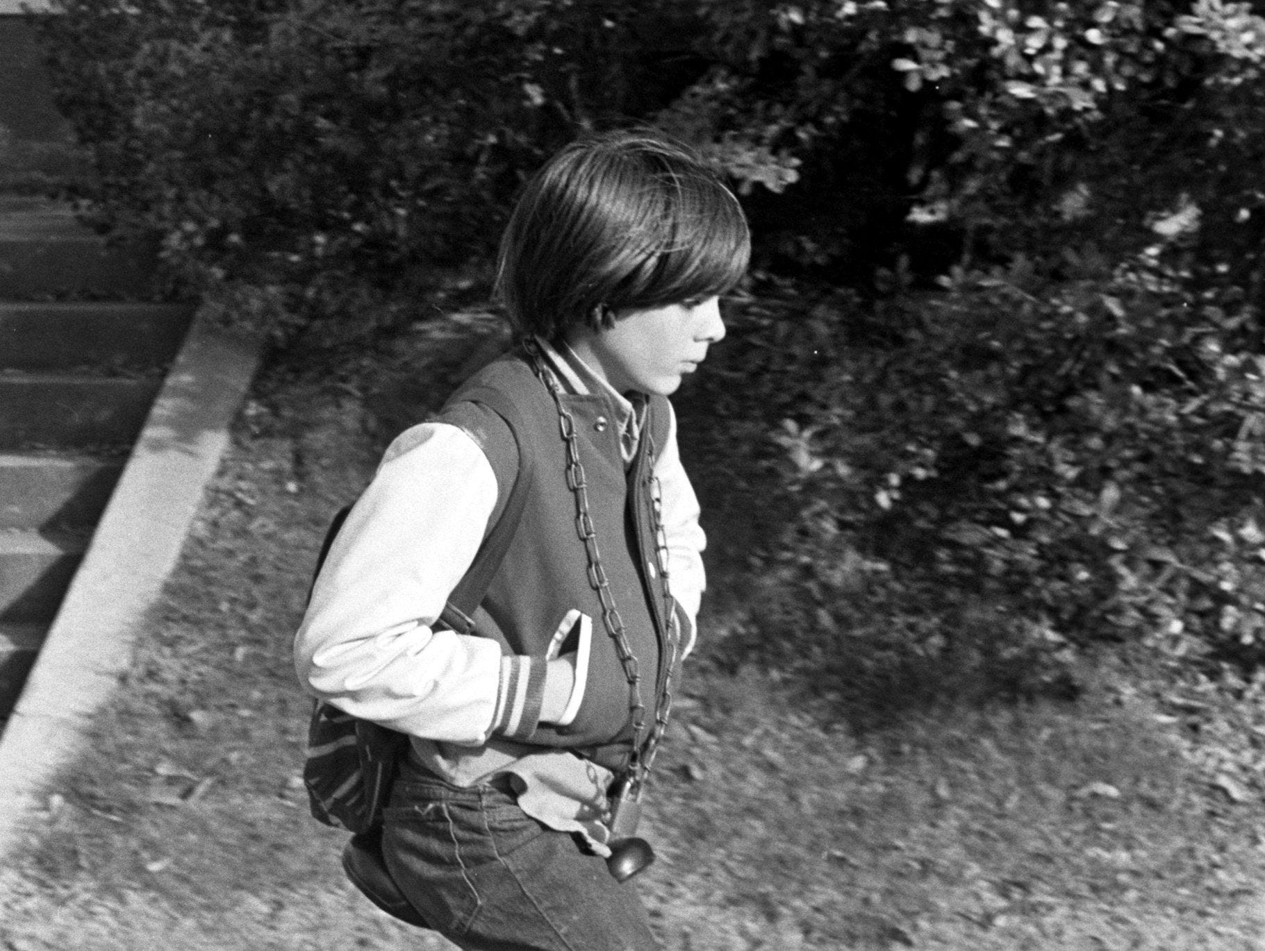 Thad Carlile, 11, of 1961 Cowden relies on his trusty unicycle to take him to school in January 1975, even when it rains. The chain around his neck is used to fasten it to the bicycle rack at Grace-St. Luke's Episcopal School, just in case. He is the son of Mr. and Mrs. Jim Carlile.