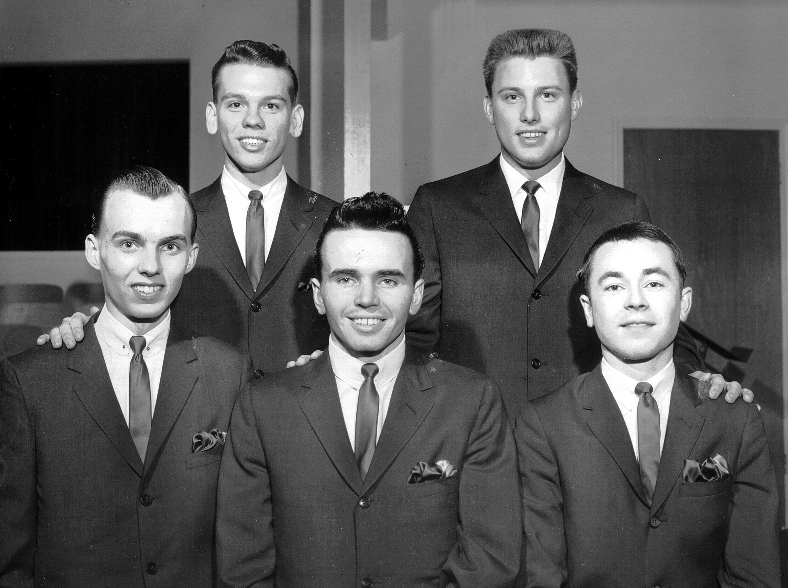 Four young Memphis men were following in the well-known footsteps of their fathers in March 1963. Three of the newly formed group, which calls itself the Blackwood Junior Quartet, are sons of original members of the group who died in a plane crash nearly nine years ago. The group includes from left (front row) James Blackwood Jr., Ronald Blackwood, Winston Blackwood and (back row) Everett Reece, pianist, and Bill Lyles Jr. Lyles is the son of Bill Lyles, bass member of the original group. Ronald and Winston are sons of the late R.W. Blackwood, who was the famed baritone.