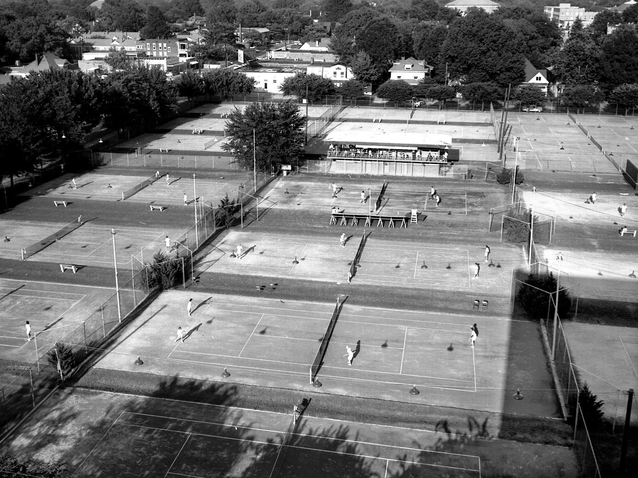 John Rogers Tennis Center in Beauregard Park teems with activity during the City Open tournament in July 1960. Jefferson Avenue is at left in this photograph taken looking toward the east.