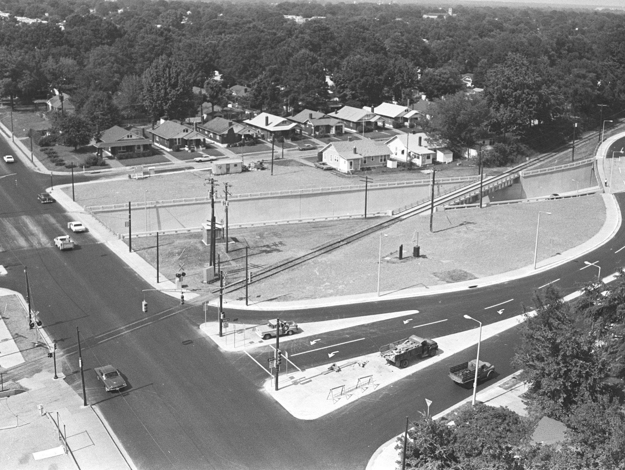 The North Parkway underpass at North Watkins (street at left edge of photograph) opened to traffic in June 1968 after being under construction for 19 months. Construction had caused several detours to be set up in the area from Claybrook to Stonewall. The depressed highway, in planning for more than 10 years, was financed with state and federal funds but has no connection with the proposed east-west expressway. North Parkway runs across the center of the photograph, which was taken looking to the northeast.