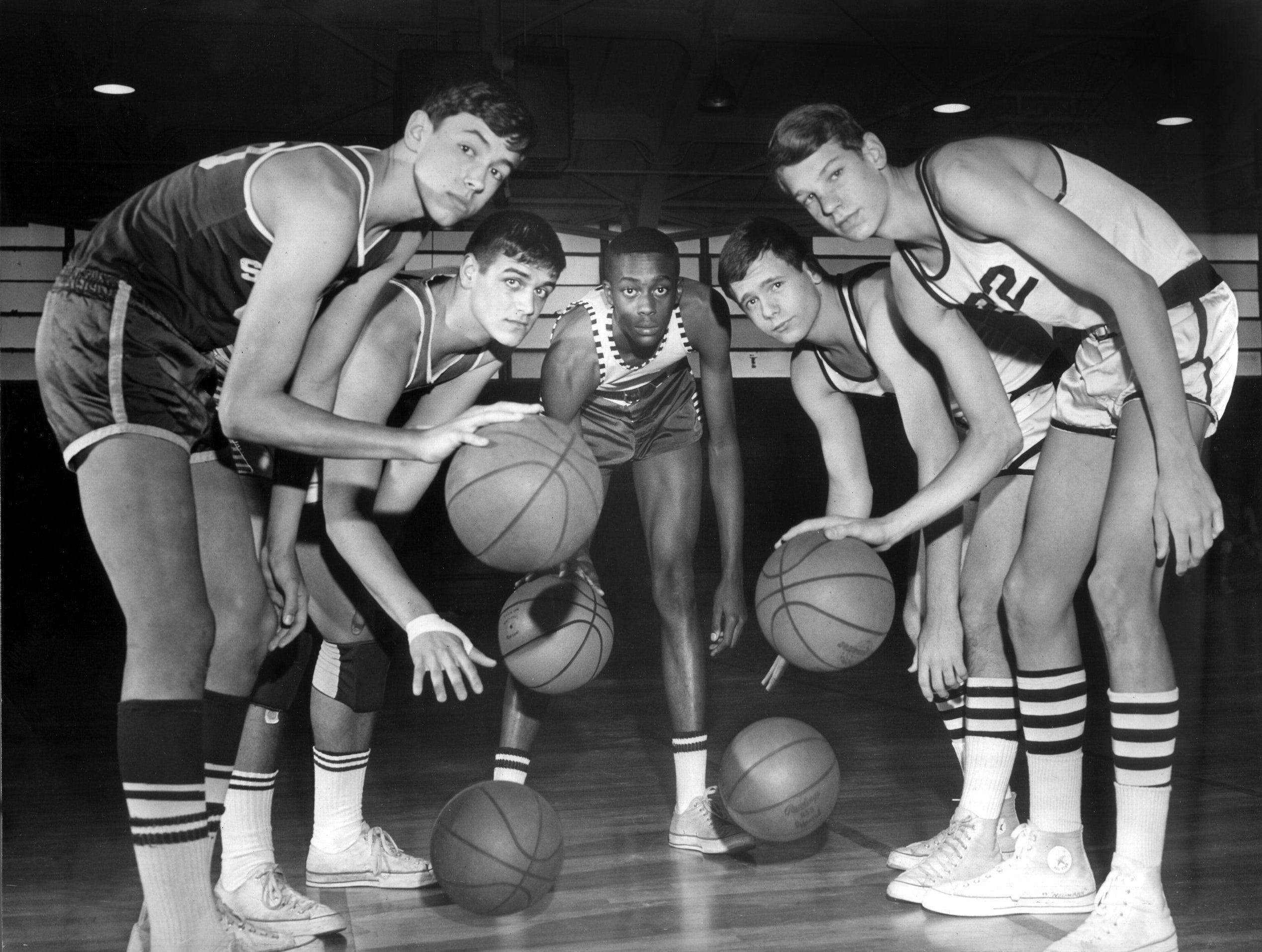 "From left, Guard Alex Thompson of White Station, Center Rad Andrews of Snowden, Forward Walter ""Slim"" Williams of Hollywood, Forward Winston McClain of Colonial and Guard Johnny Neumann of Colonial comprise the 1966 All Memphis Junior High team. All are ninth graders."