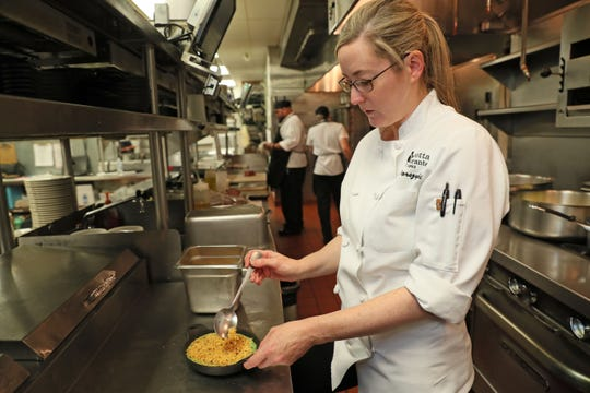 Chef Amber Dorszynski, executive chef at Mr. B's Steakhouse in Mequon, puts the final touches on a creamed spinach dish at work.