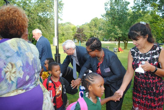 Tony Evers, the state school superintendent and Democratic candidate for governor, greets students on the first day of school Tuesday at Maple Tree Elementary in Milwaukee.