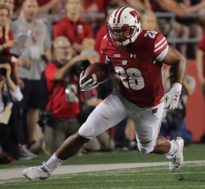 UW running back Taiwan Deal was happy with his playing time in the opener Friday after missing the 2017 season with an injury.