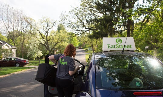 A EatStreet employee delivers food to a customer. EatStreet, Wisconsin's homegrown online food ordering company, is launching restaurant delivery for 25 restaurants in West Allis and Wauwatosa.