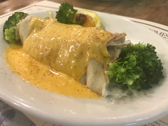 Cream & Crepe Cafe features a number of specialty entree crepes such as the Dusty Miller with turkey, broccoli, mushrooms and onions topped with cheddar cheese sauce.