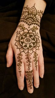 Henna tattoo artist Renee Bebeau will be at the first West Allis Art on the Plaza event to be held Friday, Sept. 14.