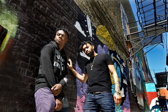"""Milwaukee rappers and brothers IshDARR (Ishmael Ali), left and BoodahDARR (Isaiah Ali) have roles in the upcoming movie """"White Boy Rick"""" starring Matthew McConaughey. The brothers are photographed on Thursday, Aug. 30, 2018 at the Black Cat Alley in Milwaukee. Angela Peterson/Milwaukee Journal Sentinel"""