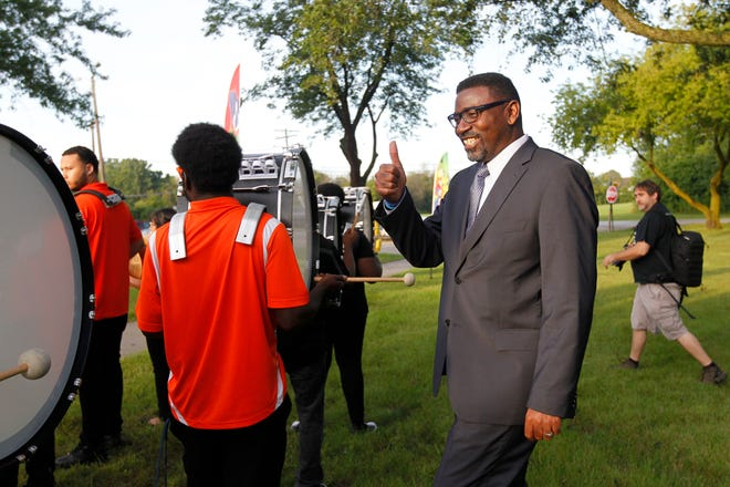 Milwaukee Public Schools Superintendent Keith Posley gives a thumbs up to the Riverside Band playing at Maple Tree Elementary School in Milwaukee. Maple Tree was the designated school for MPS to kick off the 2018-'19 school year.