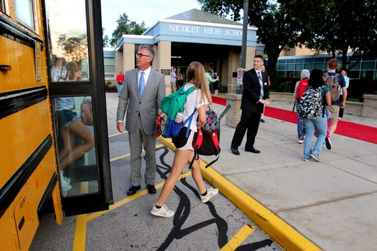 Nicolet School District Superintendent Robert Kobylski and High School Principal Greg Kabara greet students as they arrive by bus and head for the red carpet for the first day of the 2018-19 school year on Sept. 4. Kobylski will be leaving the district June 1 to take a similar role in Davenport, Iowa. Kabara will become superintendent of just Nicolet High School July 1.