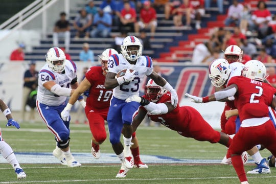 Louisiana Tech redshirt junior running back Jaqwis Dancy (23) totes the ball against South Alabama in the season opener at Ladd-Peeples Stadium Saturday, Sept. 1.