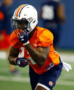 Auburn wide receiver Eli Stove runs drills during practice on Friday, Aug. 3, 2018, in Auburn, Ala.