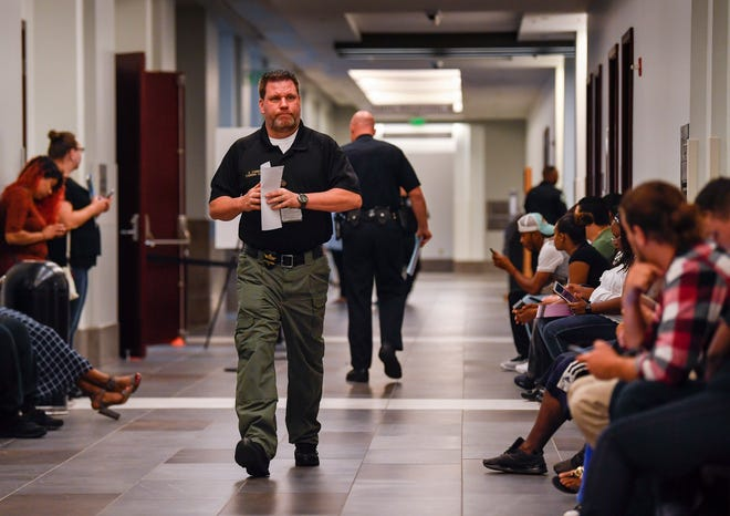 Steering Clear case manager Kevin Corbitt walks past people waiting to see if they can be helped by the new sheriff's office program, which helps people gettheir licenses reinstated, Tuesday, Sept. 4, 2018, at the Justice A.A. Birch Building in Nashville.