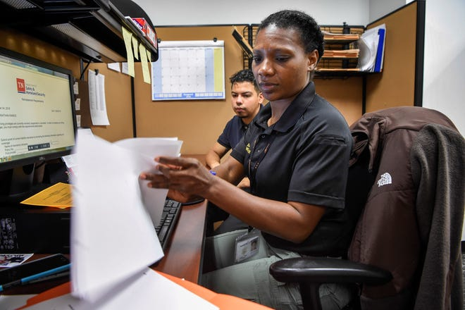 Steering Clear Program case manager Joshilyn Baker works with Jonathan Ramos through the process of clearing a citation to get his driver's licenses back Sept. 4, 2018.