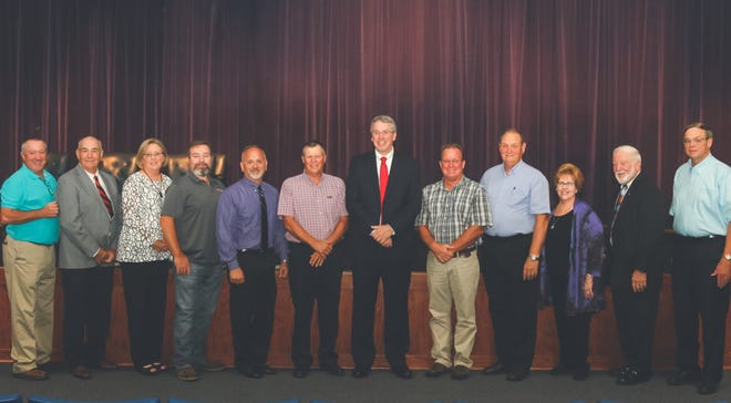 At the Dickson County officials Oath of Office ceremony Thursday were, center, Mayor Bob Rial and the county commissioners.