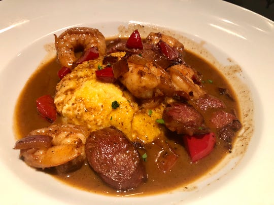 Shrimp and grits made with blackened Gulf shrimp and andouille sausage on a bed of cheesy grits at The Pearl Steak and Seafood Restaurant in North Naples.