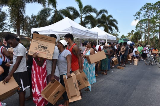 Crowds line up for the Harry Chapin Food Bank pantry at Parkside Elementary School in East Naples after Hurricane Irma in September 2017.