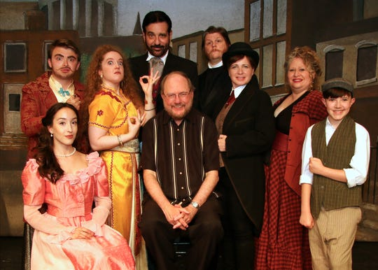 Rupert Holmes surrounded by principal cast members, clockwise from lower left: Taylor Rose Rizzotti, Steve Munoz, Elaine Thoman, Larry Brustofski, Bryan John Morris, Nancy Feldman, Janica Carpenter, Louie X. Aiello.  P