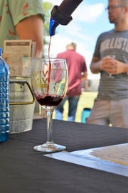 A dry Malbec from Amaro Winery located in Las Cruces is being poured into this year's featured wine glass for the Las Cruces' Harvest Wine Festival held over the Labor Day weekend.