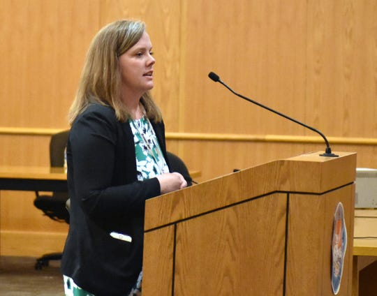 Doña Ana County Chief Deputy Clerk Lindsey Bachman addresses the Doña Ana County Board of County Commissioners during a special meeting Tuesday, Sept. 4, 2018 in Las Cruces. The commission voted 4-1 to state its opposition to straight-party voting.